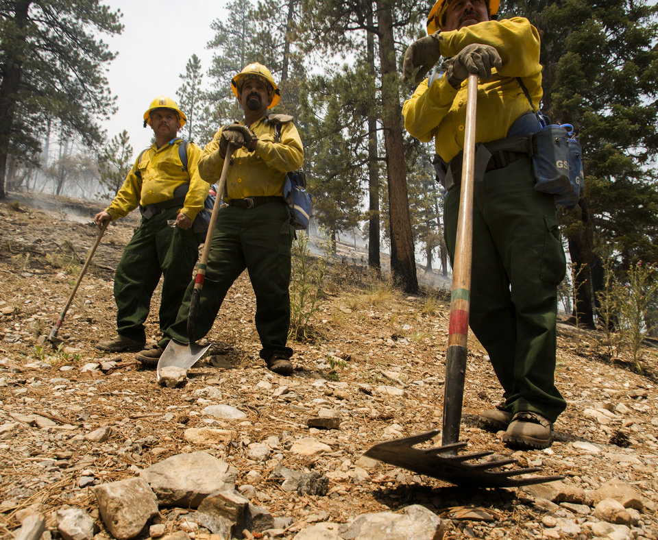 Photo - A Type 2 firefighters from Sequoia National Forest take a break from the Carpenter 1 Fire at the Rainbow subdivision on Mt. Charleston near Las Vegas on Tuesday, July 9, 2013. The lightning-caused fire, which started on July 1, has burned nearly 20,000 acres. Over 800 firefightersl are working the blaze  in the Spring Mountains National Recreation Area. (AP Photo/Las Vegas Review-Journal, Jeff Scheid)