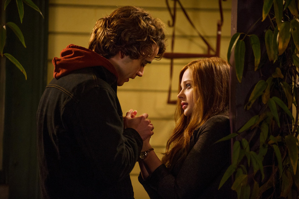 """Photo -  Jamie Blackley, left, and Chloe Grace Moretz are shown in a scene from """"If I Stay."""" AP Photo   Doane Gregory -"""