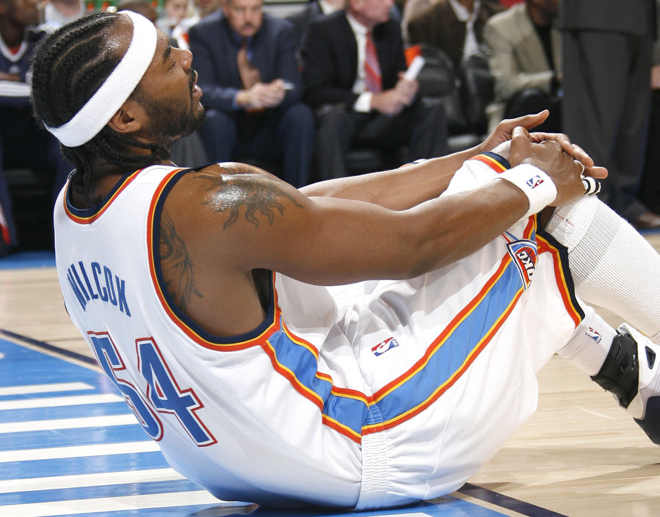 Photo - Oklahoma City forward Chris Wilcox holds his knee after and injury during the first half of the NBA game between Oklahoma City Thunder and the Atlanta Hawks, Sunday, Nov. 9, 2008, at  the Ford Center, Oklahoma City. PHOTO BY SARAH PHIPPS, THE OKLAHOMAN
