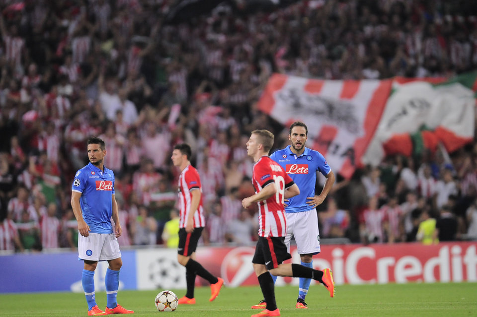 Photo - SSC Napoli's Gonzalo Higuain, right, laments after his team lose their match 3-1 against Athletic Bilbao,  during their Champions League playoff second leg soccer match, at San Mames stadium in Bilbao, northern Spain, Wednesday, Aug. 27, 2014.(AP Photo/Alvaro Barrientos)