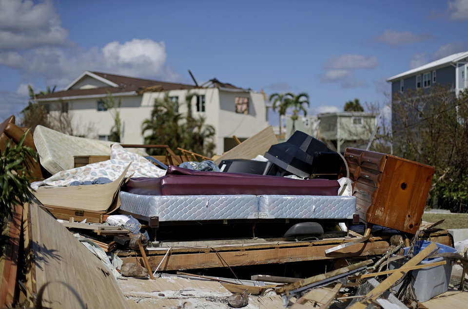 Photo - A bed sits amongst the remains of its room in a home demolished from Hurricane Irma in Goodland, Fla., Tuesday, Sept. 12, 2017. (AP Photo/David Goldman)