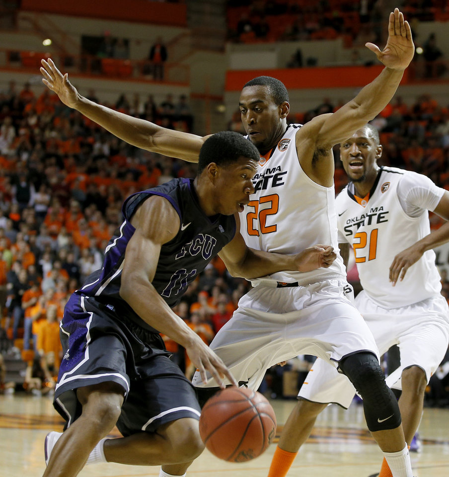 Photo - Oklahoma State's Markel Brown (22) defends TCU's Jarvis Ray (22) during an NCAA college basketball game between Oklahoma State University (OSU) and TCU at Gallagher-Iba Arena in Stillwater, Okla., Wednesday, Jan. 15, 2014.  Photo by Bryan Terry, The Oklahoman