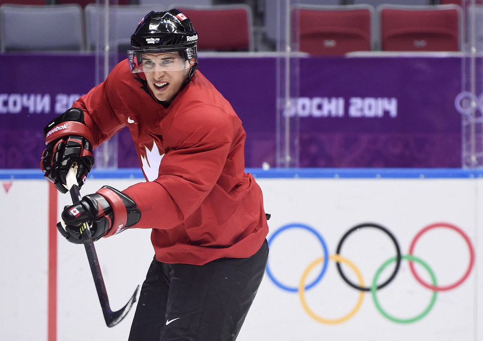 Photo - Team Canada captain Sidney Crosby shoots the puck as he takes part in a practice session during the 2014 Sochi Winter Olympics in Sochi, Russia,  on Monday, Feb. 10, 2014. (AP Photo/The Canadian Press, Nathan Denette)