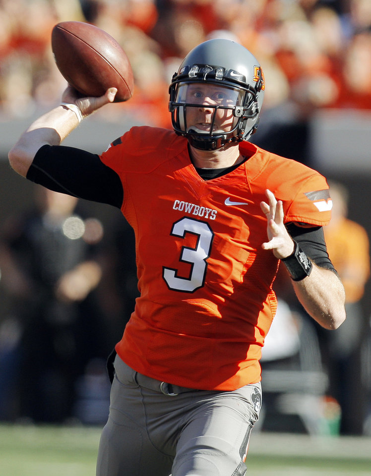 Photo - OSU's Brandon Weeden (3) passes the ball during a college football game between the Oklahoma State University Cowboys (OSU) and the Baylor University Bears (BU) at Boone Pickens Stadium in Stillwater, Okla., Saturday, Oct. 29, 2011. Photo by Nate Billings, The Oklahoman