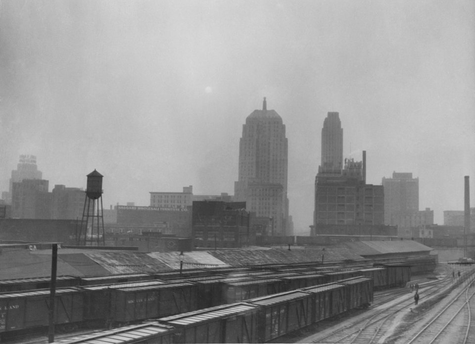Train yard in Oklahoma City during a dust storm.  Staff Photo by Alphia O. Hart.  Dated 3/23/1936.