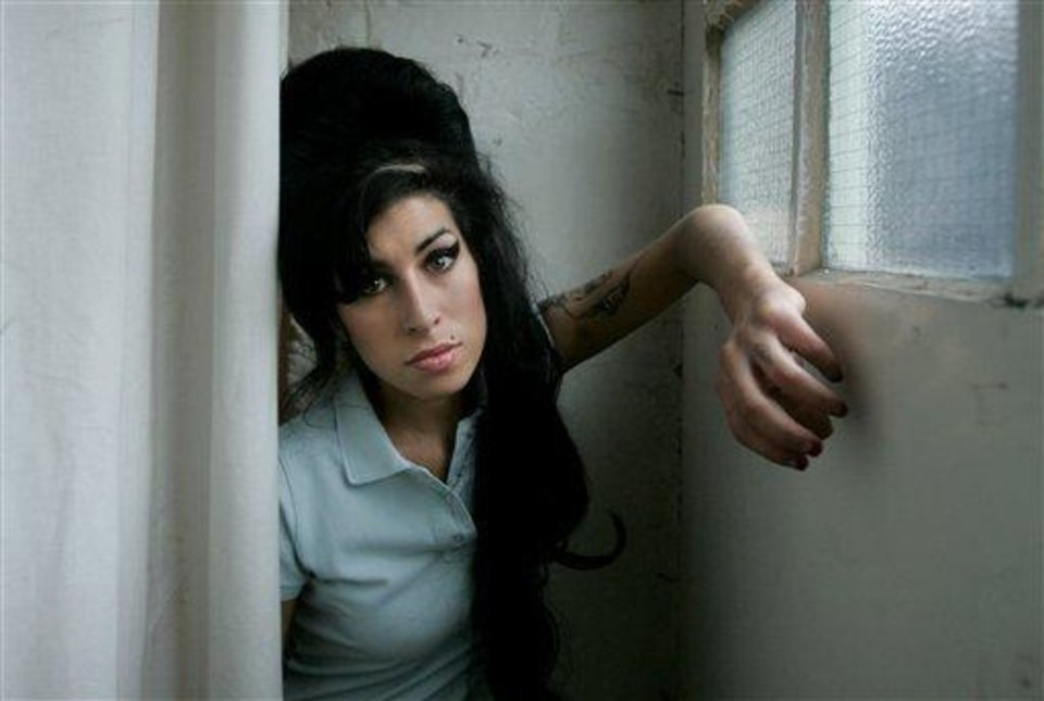 Photo - FILE - In this Feb. 16, 2007 file photo, British singer Amy Winehouse poses for photographs after being interviewed by The Associated Press at a studio in north London, Friday, Feb. 16, 2007. British police say singer Amy Winehouse has been found dead at her home in London on Saturday, July 23, 2011. The singer was 27 years old. (AP Photo/Matt Dunham, File)