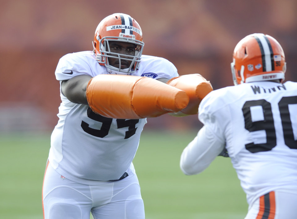 Photo - Cleveland Browns defensive lineman Nicolas Jean-Baptiste practices  during NFL football training camp at the team's facility in Berea, Ohio Wednesday, July 31, 2013. (AP Photo/David Richard)