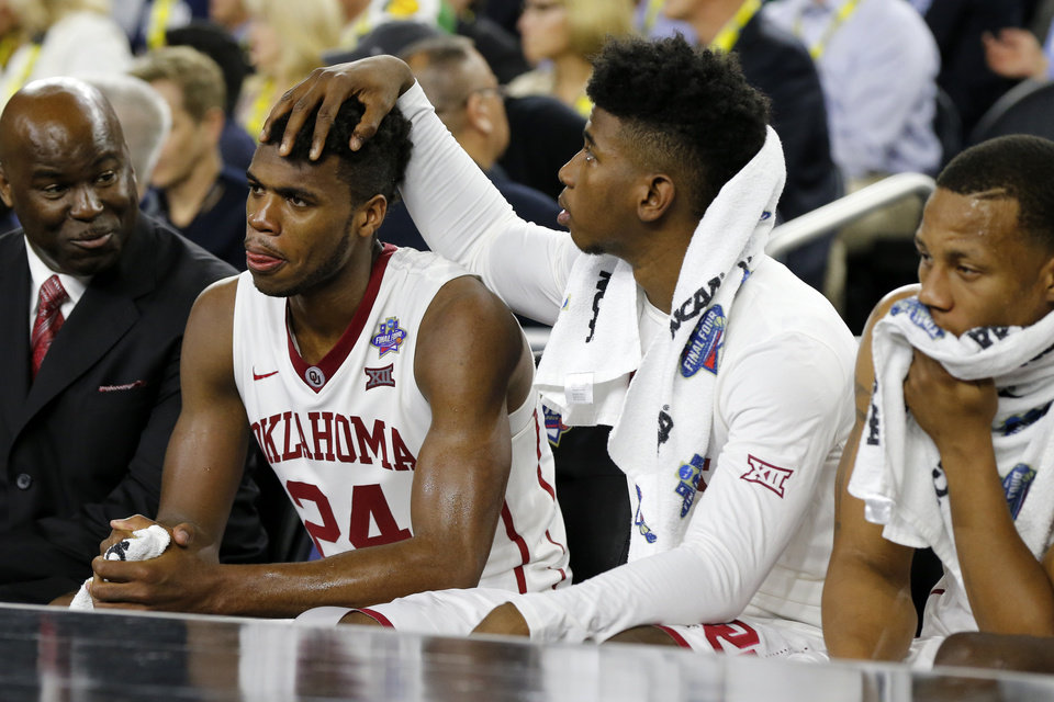 Photo - Oklahoma's Buddy Hield (24) is consoled by Christian James  during the national semifinal between the Oklahoma Sooners (OU) and the Villanova Wildcats in the Final Four of the NCAA Men's Basketball Championship at NRG Stadium in Houston, Saturday, April 2, 2016. Photo by Nate Billings, The Oklahoman