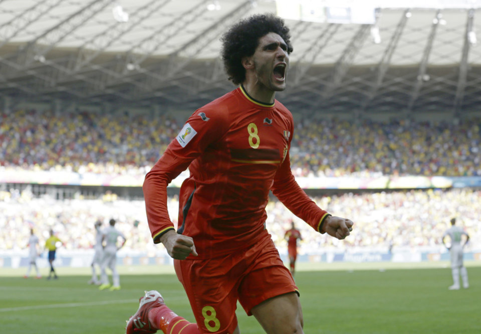 Photo - Belgium's Marouane Fellaini celebrates after scoring his side's first goal during the group H World Cup soccer match between Belgium and Algeria at the Mineirao Stadium in Belo Horizonte, Brazil, Tuesday, June 17, 2014.  (AP Photo/Hassan Ammar)