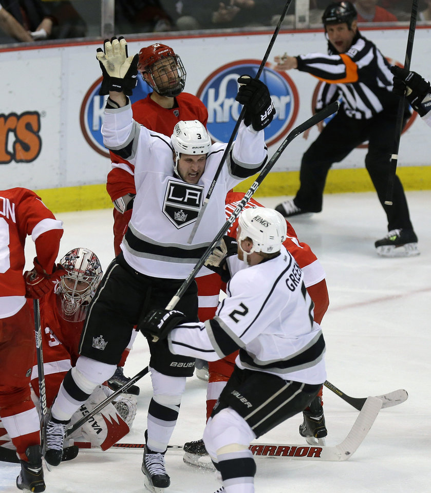 Photo - Los Angeles Kings left wing Kyle Clifford, center, celebrates his goal on Detroit Red Wings goalie Jimmy Howard (35) during the second period of an NHL hockey game in Detroit, Wednesday, April 24, 2013. (AP Photo/Carlos Osorio)