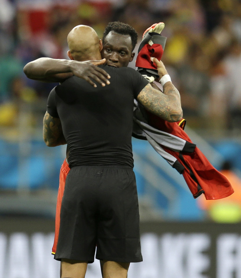 Photo - United States' goalkeeper Tim Howard is consoled by Belgium's Romelu Lukaku during the World Cup round of 16 soccer match between Belgium and the USA at the Arena Fonte Nova in Salvador, Brazil, Tuesday, July 1, 2014. (AP Photo/Natacha Pisarenko)