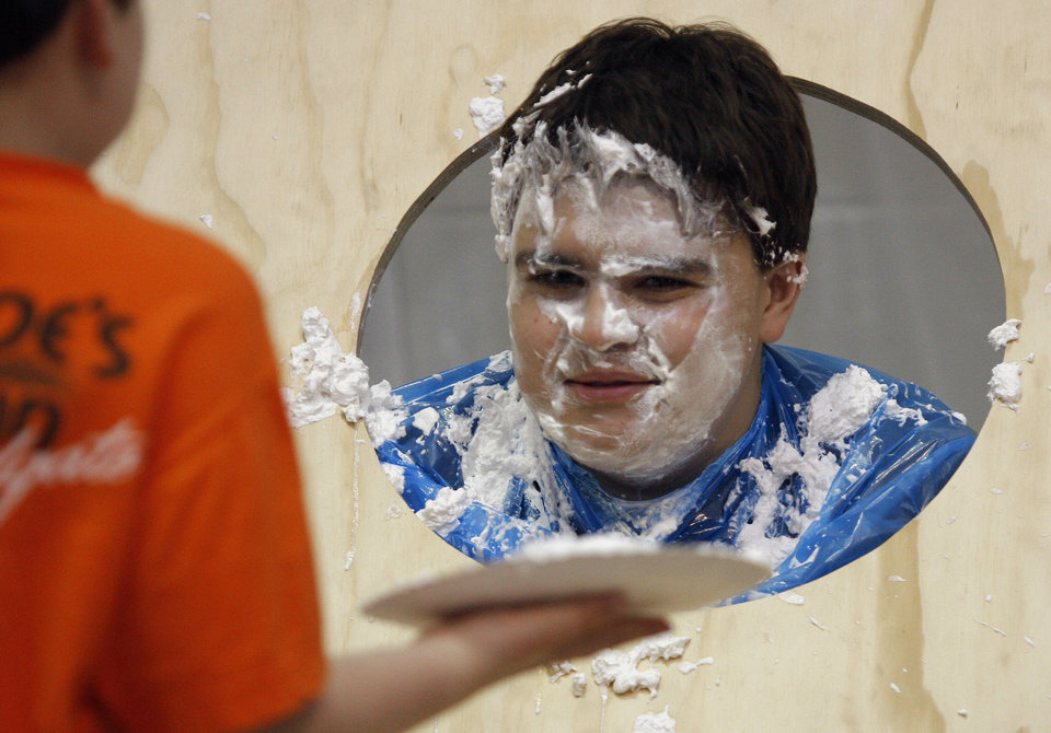Edmond Memorial High School sophomore Will Walderbich, 16, prepares himself for another pie in the face during a carnival for Swine Week, Tuesday, March 10, 2009, at Edmond Memorial High School in Edmond, Okla. BY BRENDA O\'BRIAN, THE OKLAHOMAN
