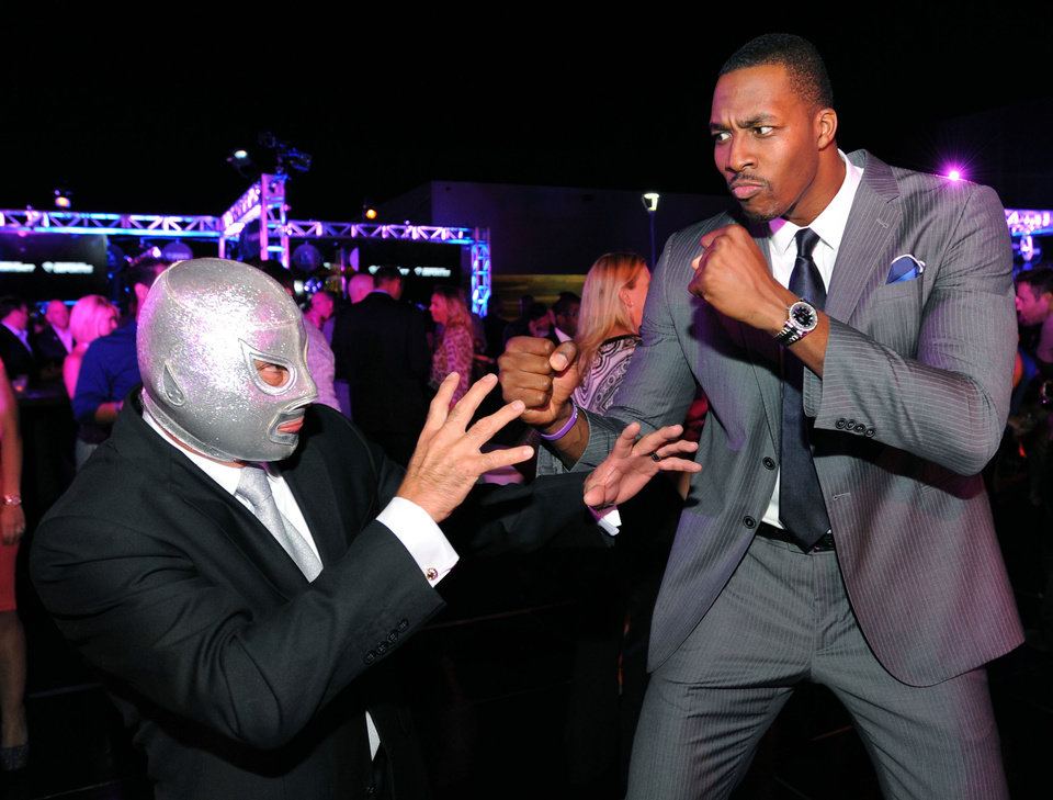 IMAGE DISTRIBUTED FOR TIME WARNER CABLE - El Hijo Del Santo, left, and Dwight Howard attend the Time Warner Cable SportsNet and Time Warner Cable Deportes Networks launch event hosted by Time Warner Cable Sports on Monday, Oct. 1, 2012, in Los Angeles. (Photo by Jordan Strauss/Invision for Time Warner Cable/AP Images)