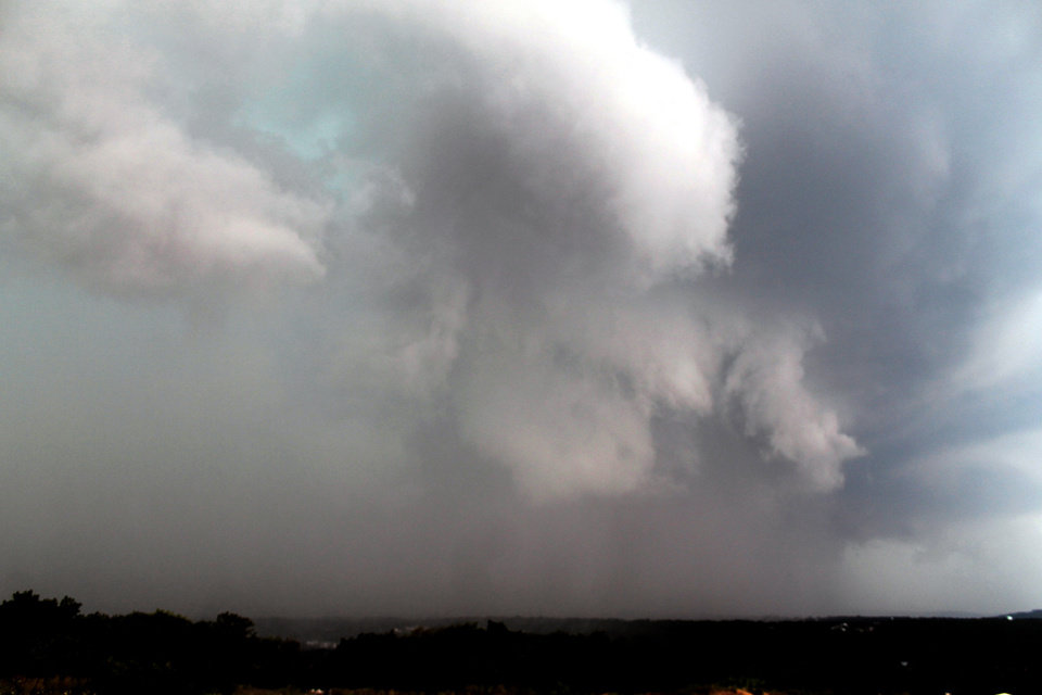 Photo -   A thunderstorm rolls into the Greater Hazleton, Pa. area on Thursday, July 26, 2012. An outbreak of severe thunderstorms including widespread damaging winds are sweeping over parts of the Ohio Valley and the northeast. (AP Photo/Hazleton Standard-Speaker, Jamie Pesotine)