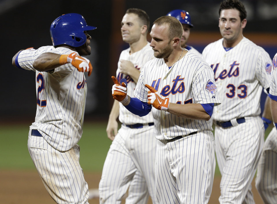 Photo - New York Mets' Andrew Brown, center, celebrates his game winning single during the 13th inning of the baseball game against the Arizona Diamondbacks at Citi Field, Tuesday, July 2, 2013, in New York. The Mets beat the Diamondbacks 5-4. (AP Photo/Seth Wenig)