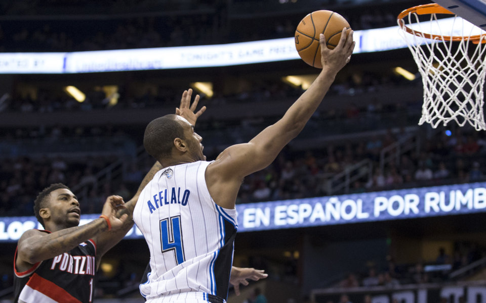Photo - Orlando Magic's Arron Afflalo drives to the basket for two points against the Portland Trail Blazers' Dorell Wright during the first half of an NBA basketball game in Orlando, Fla., Tuesday, March 25, 2014. (AP Photo/Willie J. Allen Jr.)