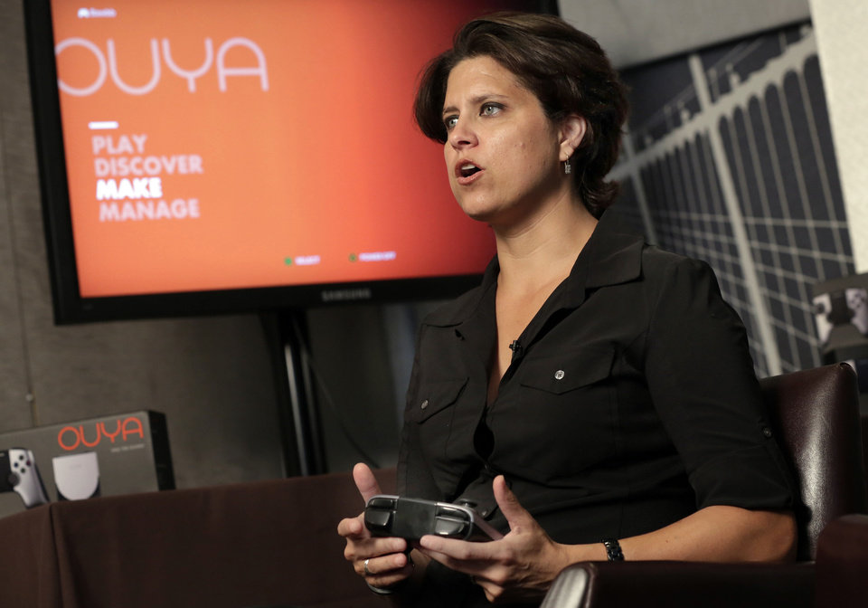 Photo - Julie Uhrman, chief executive of Android game console maker Ouya, is interviewed in New York, Tuesday, June 25, 2013.  Ouya, that went on sale Tuesday for $99, aims to challenge the dominance of the Xboxes, Nintendos and PlayStations of the world. The launch follows a successful funding campaign through the group-fundraising site Kickstarter, but it's unclear whether the console will enjoy broader success. (AP Photo/Richard Drew) ORG XMIT: NYRD103