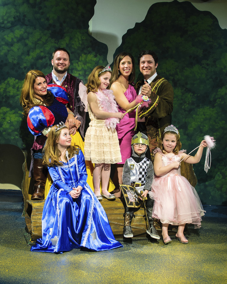 Preparing for the Fairy Tale Ball are, from left, Kristen and Matt Brown and Katherine and Cooper Johnson and their children, Bella Brown, Hannah Kate Johnson, Mica Brown and Hailey Jane Johnson.  PHOTO PROVIDED BY OKLAHOMA CHILDREN�S THEATRE