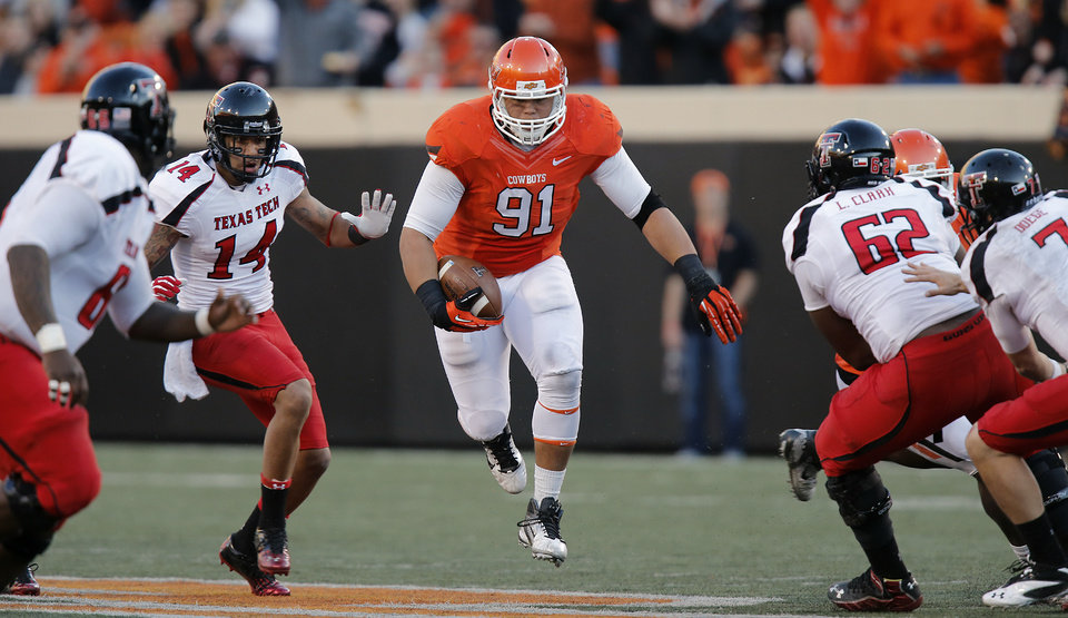 Oklahoma State's James Castleman (91) runs with the ball after making an interception during the college football game between the Oklahoma State University Cowboys (OSU) and Texas Tech University Red Raiders (TTU) at Boone Pickens Stadium on Saturday, Nov. 17, 2012, in Stillwater, Okla.   Photo by Chris Landsberger, The Oklahoman