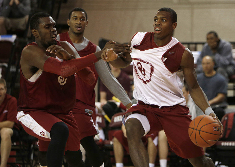 Buddy Hield (3) runs past Andrew Fitzgerald (4) during a Oklahoma University scrimmage basketball game at McCasland Field House in Norman, Okla., Saturday, Oct. 20, 2012.  Photo by Garett Fisbeck, The Oklahoman