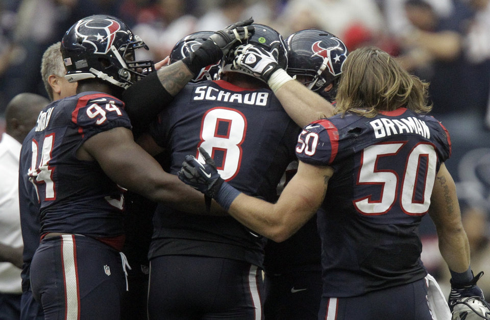 Photo -   The Houston Texans celebrate their 43-37 win over the Jacksonville Jaguars in overtime at an NFL football game on Sunday, Nov. 18, 2012, in Houston. (AP Photo/Patric Schneider)