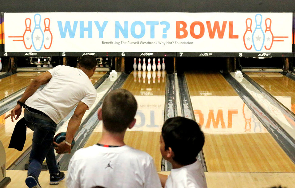 "Photo - Oklahoma City Thunder Player, Russell Westbrook, bowling at his fundraising event ""Why Not? Bowl"" on Thursday, April 9, 2015 at AMF Boulevard Lanes in Edmond, Oklahoma. Photo by Alyssa Ramsey, The Oklahoman"