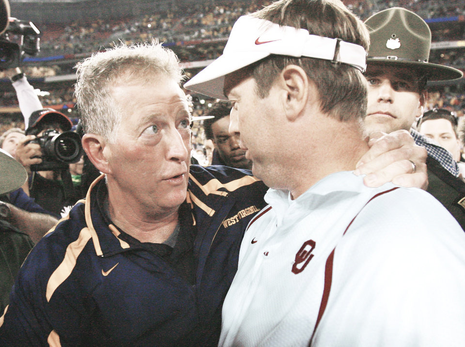 Photo - There's a lot on the line when Bob Stoops' Oklahoma squadron meets Florida for the BCS title in January. Stoops doesn't want a repeat of last year's Fiesta Bowl loss. West Virginia and coach Bill Stewart beat OU 48-28.   OKLAHOMAN ARCHIVE