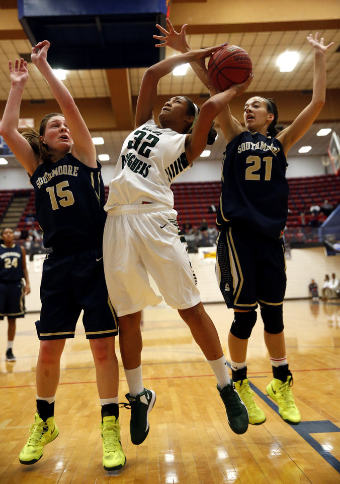 Muskogee's Lanice Rozell (32) shoots guarded by  Southmoore's Kyra Gilbert (15) and Kayla Tucker (21) in the girls championship of the John Nobles Invitational Tournament on Saturday, Jan. 26, 2013  in Moore, Okla. Photo by Steve Sisney, The Oklahoman