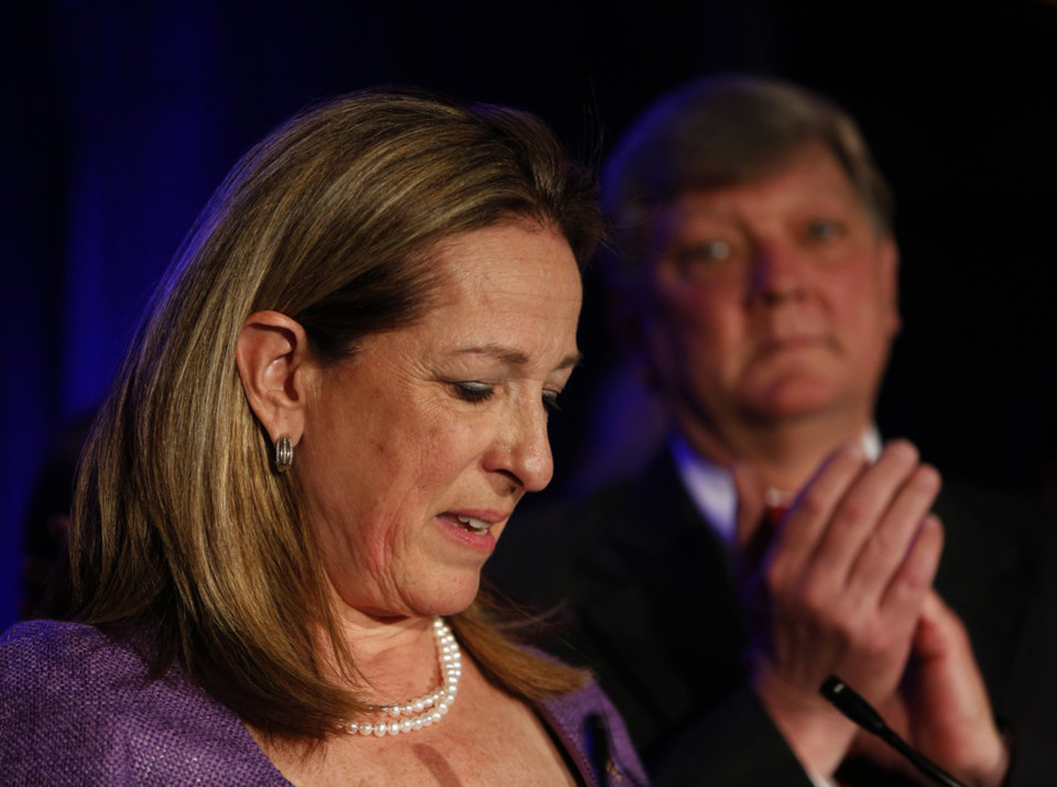 Photo - First Congressional District Democratic candidate Elizabeth Colbert Busch gives her concession speech at the Charleston Renaissance Hotel after losing to Republican Mark SanfordTuesday, May 7, 2013, in Charleston S.C.  In back is her husband Claus Busch. The two were running in a special election for the state's vacant 1st District congressional seat. (AP Photo/Mic Smith)