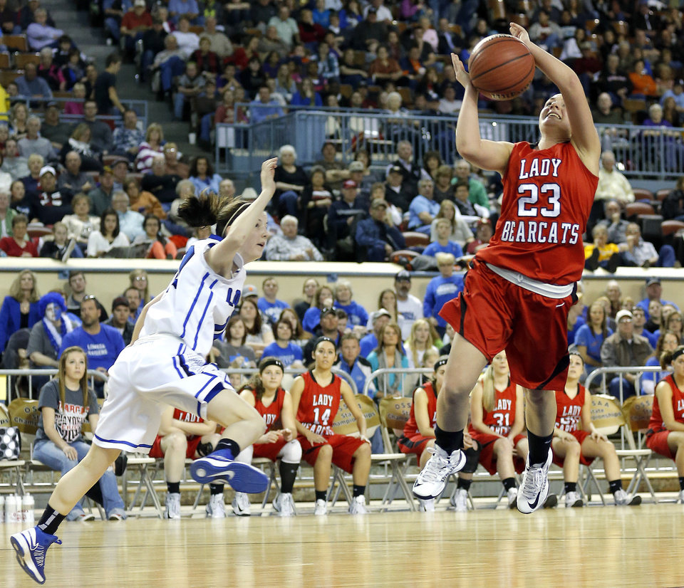 Erick's Shyli May shoots a lay up as Lomega's Kylie Turner defends during the Class B girls state championship between Erick and Lomega at the State Fair Arena.,  Saturday, March 2, 2013. Photo by Sarah Phipps, The Oklahoman