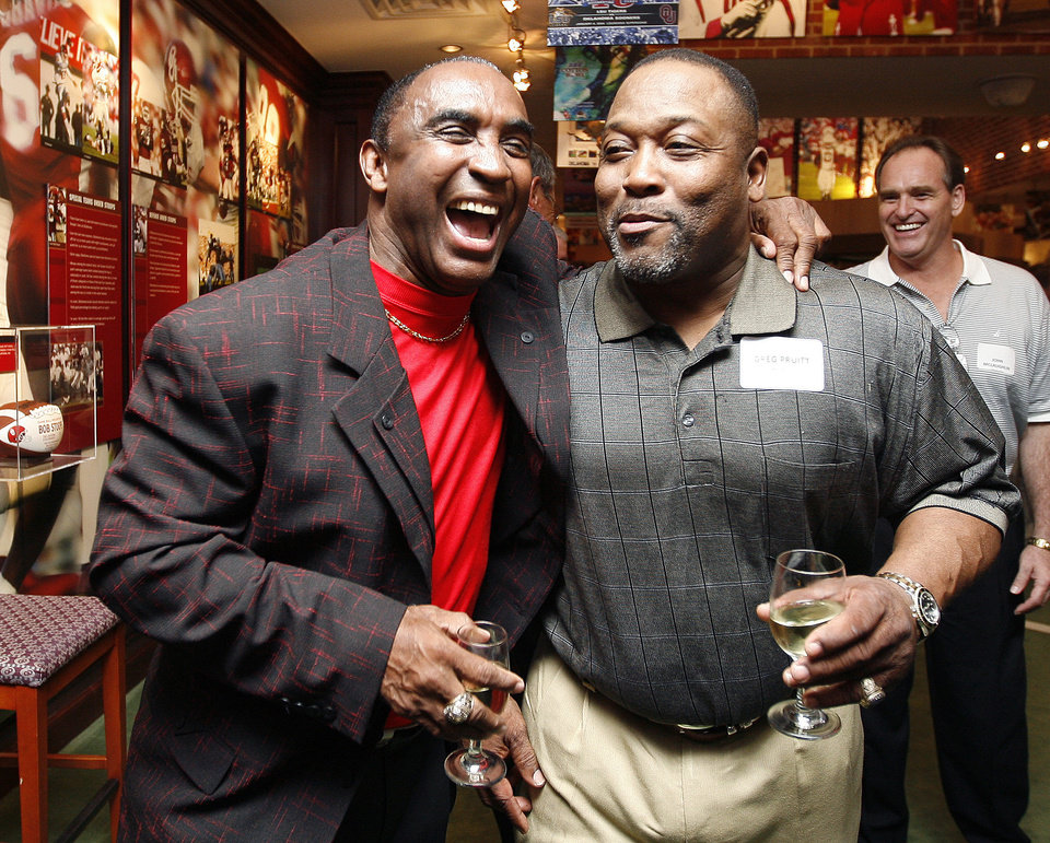 Photo - From left, Johnny Rodgers, of Nebraska, and Greg Pruitt of OU talk in Norman, Okla., Friday, October 31, 2008, during a reunion for the 1971 Game of the Century between the University of Oklahoma and Nebraska. BY BRYAN TERRY, THE OKLAHOMAN ORG XMIT: KOD