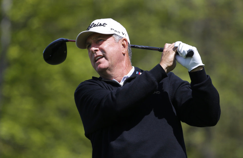 Photo - Jay Haas watches his drive from the 12th tee during the first round of the 75th Senior PGA Championship golf tournament at the Harbor Shores Golf Club in Benton Harbor, Mich., Thursday, May 22, 2014.  (AP Photo/Paul Sancya)