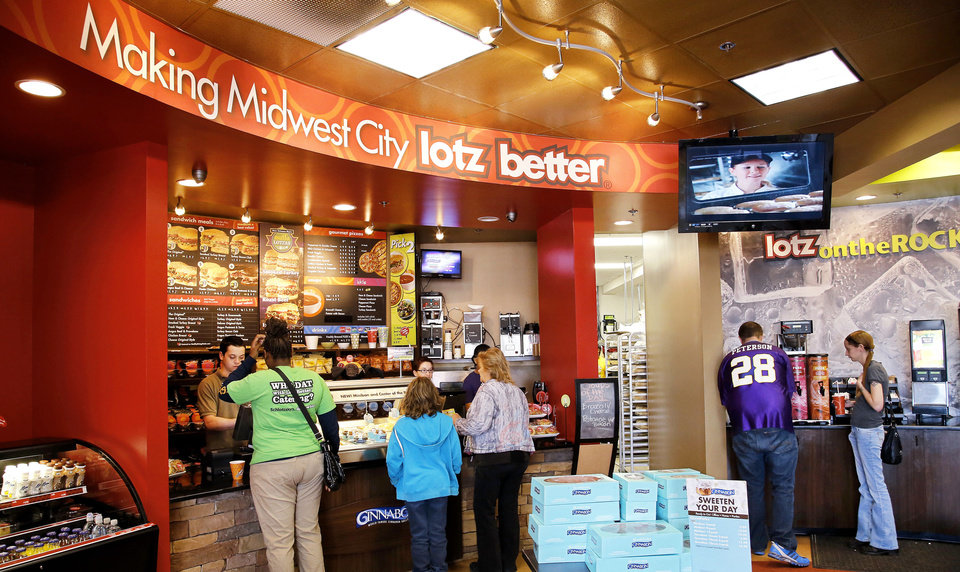 Customers enjoy the upscale touches at the Midwest City Schlotzsky�s, which has a fireplace, media wall with TVs and Wi-Fi and an outdoor fountain and patio. Photos by Jim Beckel, THE OKLAHOMAN