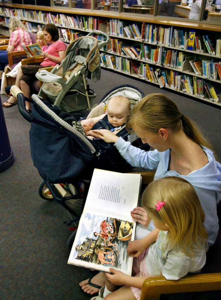 Alissa Finley reads to two of her children, 4-year-old Anna and 9-month-old Fin Dalrymple, at the Norman Public Library in Norman, Oklahoma on Thursday, May 22, 2008.  BY STEVE SISNEY, THE OKLAHOMAN