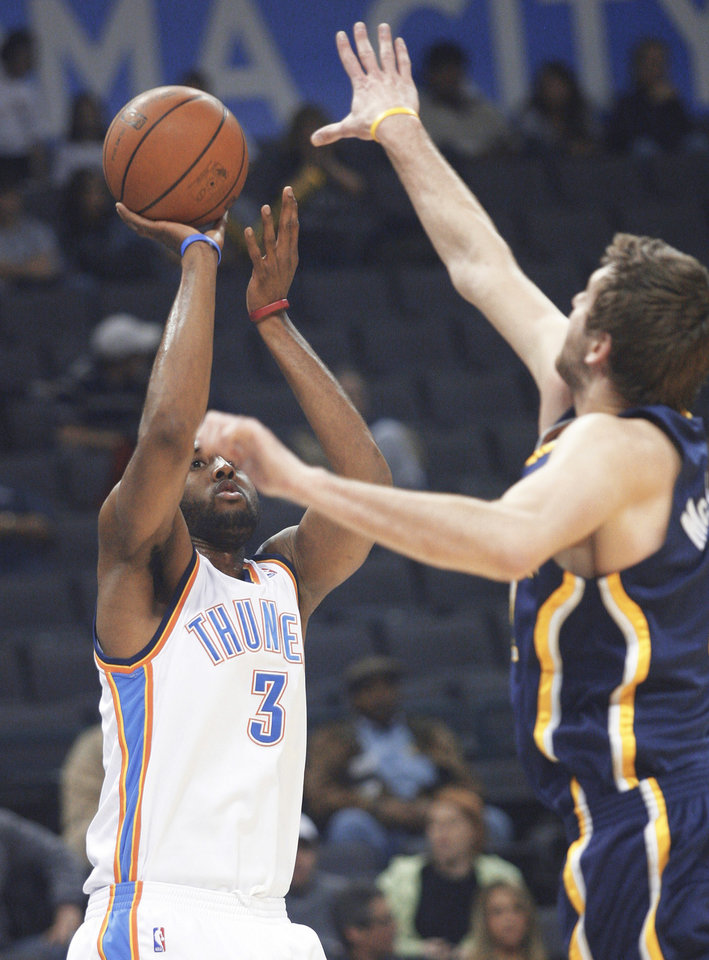 Photo - Oklahoma City forward D.J. White, left, takes a shot during the Thunder's 117-99 loss to Indiana on Sunday. White scored 14 points in his NBA debut. Ap photo