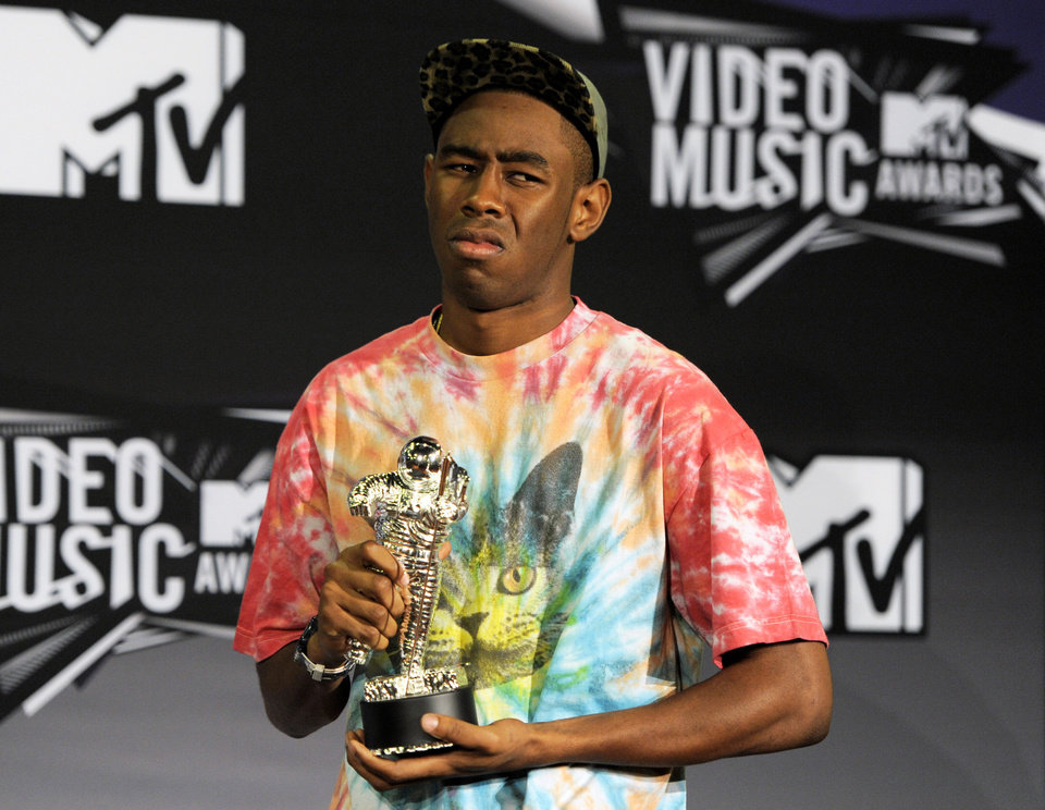 Photo - FILE - This Aug. 28, 2011 file photo shows Tyler the Creator posing backstage with the award for best new artist backstage at the MTV Video Music Awards in Los Angeles. PepsiCo cut ties with Lil Wayne in May 2013; it was the same week the company pulled an online Mountain Dew ad, developed by rapper Tyler, the Creator, that was criticized for portraying racial stereotypes and making light of violence toward women. (AP Photo/Chris Pizzello, file)