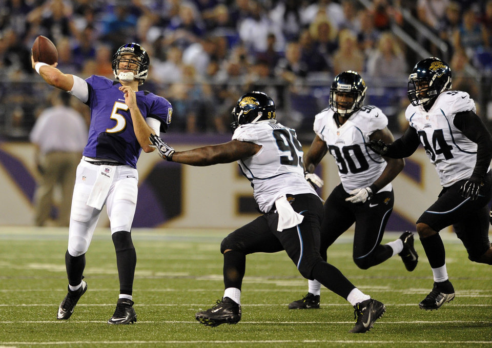 Photo -   Baltimore Ravens quarterback Joe Flacco (5) throws to a receiver as he is pressured by Jacksonville Jaguars defensive lineman C.J. Mosley (99), defensive end Andre Branch (90) and defensive lineman Jeremy Mincey in the first half of an NFL preseason football game in Baltimore, Thursday, Aug. 23, 2012. (AP Photo/Nick Wass)