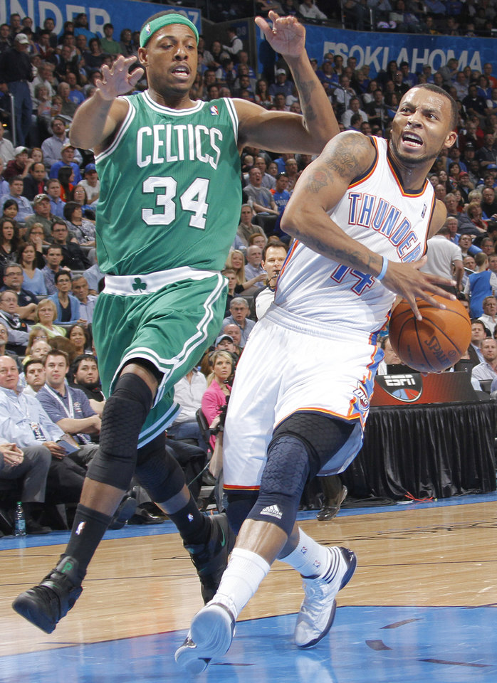 Oklahoma City Thunder shooting guard Daequan Cook (14) drives past Boston Celtics small forward Paul Pierce (34) during the NBA basketball game between the Oklahoma City Thunder and the Boston Celtics at the Chesapeake Energy Arena on Wednesday, Feb. 22, 2012 in Oklahoma City, Okla.  Photo by Chris Landsberger, The Oklahoman