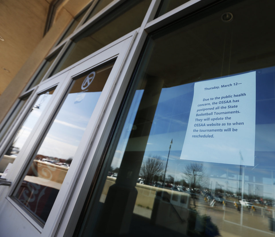 Photo - A sign announces the postponement of the state high school basketball tournament due to the new coronavirus, at Jim Norick Arena, The Big House, at State Fair Park in Oklahoma City, Thursday, March 12, 2020. [Nate Billings/The Oklahoman]
