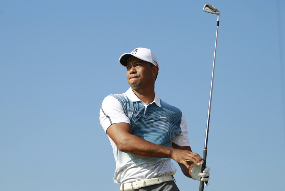 Photo - Tiger Woods of the US watches his shot off the 2nd tee during the first day of the British Open Golf championship at the Royal Liverpool golf club, Hoylake, England, Thursday July 17, 2014. (AP Photo/Peter Morrison)