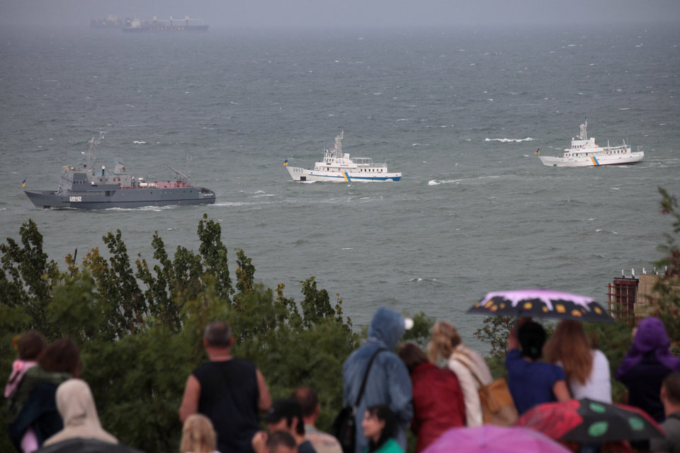 Photo - Ukrainian navy ships bob by the shore on a stormy, turbulent sea pass in Odessa's embankment, Ukraine, Sunday, Aug. 24, 2014. In another symbolic move, Poroshenko traveled south to the predominantly Russian-speaking port city of Odessa to give a second speech on Sunday. Ukraine lost much of its coastline when the Black Sea peninsula of Crimea was annexed by Russia in March, and the loyalty of local authorities in Odessa to Kiev has been a top priority for the new government. (AP Photo/Sergei Poliakov)