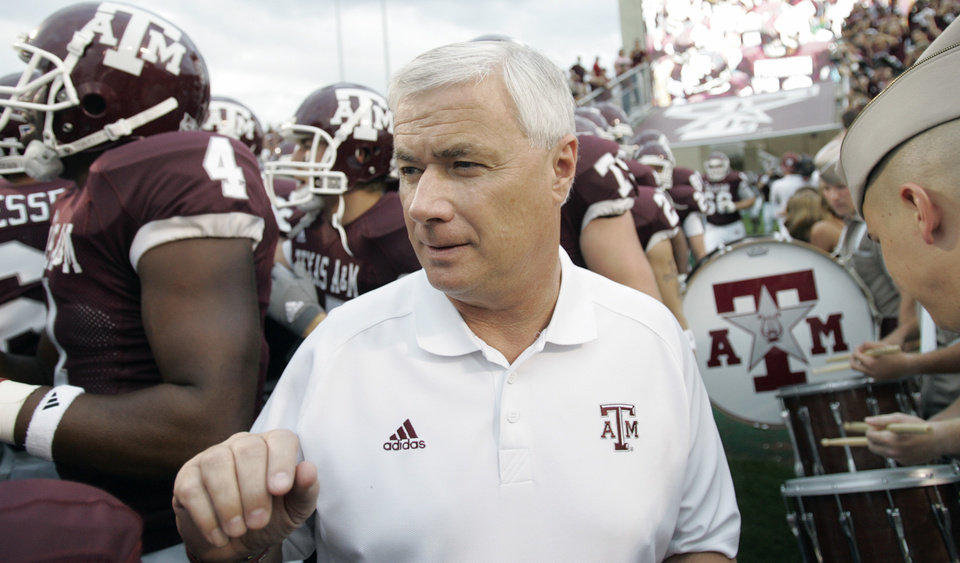 Photo - ** FILE ** TEXAS A&M UNIVERSITY VS. OKLAHOMA STATE UNIVERSITY (OSU) COLLEGE FOOTBALL: Texas A&M coach Dennis Franchione leads his team out for their football game against Oklahoma State Saturday, Oct. 6, 2007 in College Station, Texas. (AP Photo/David J. Phillip) ORG XMIT: NY151