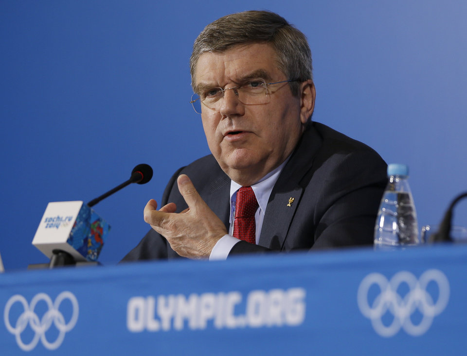 Photo - International Olympic Committee President Thomas Bach answers a question during a news conference at the 2014 Winter Olympics, Sunday, Feb. 23, 2014, in Sochi, Russia. (AP Photo/Morry Gash)
