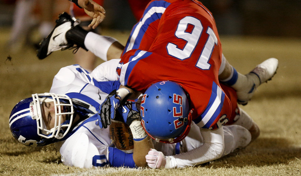 Photo - Stroud's Dalton Baade is brought down by Oklahoma Christian School's Duncan Aldridge during a high school football playoff game in Edmond, Friday, Nov. 23, 2012. Photo by Bryan Terry The Oklahoman