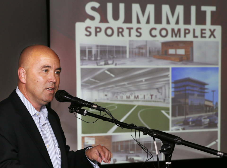 Photo - Brad Lund speaks during the unveiling of the Summit Sports Complex at the Edmond Community Center, 28 E Main St., in Edmond, Okla., Wednesday, Oct. 9, 2013. The Summit Sports Complex will be located at I-35 and Covell. The grand opening is projected to be summer of 2015. Photo by Nate Billings, The Oklahoman