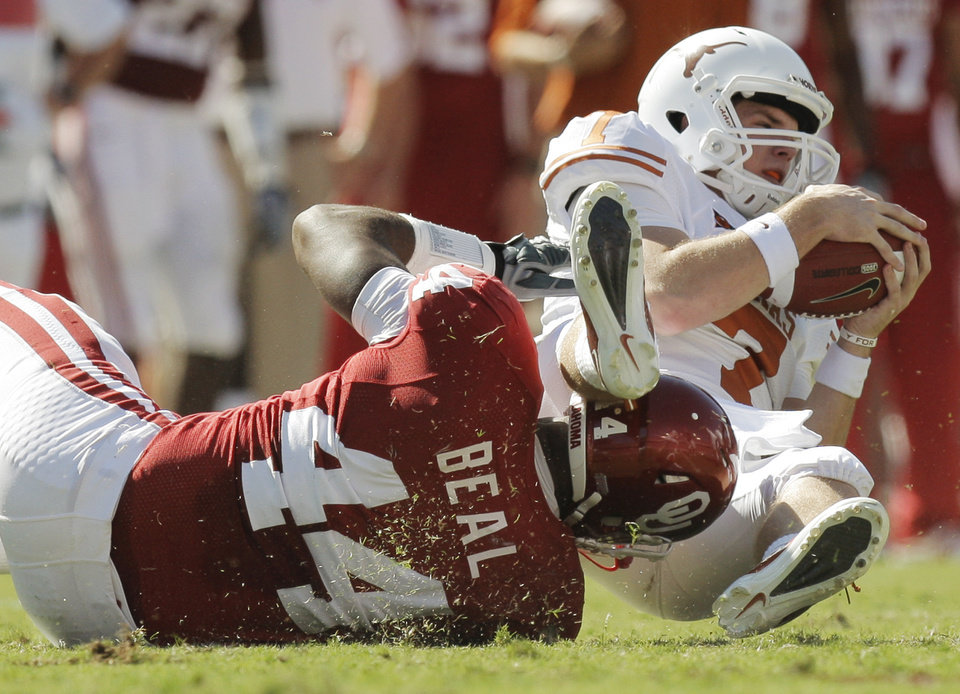 Photo - OU's Jeremy Beal (44) sacks Texas quarterback Garrett Gilbert (7) in the second quarter during the Red River Rivalry college football game between the University of Oklahoma Sooners (OU) and the University of Texas Longhorns (UT) at the Cotton Bowl on Saturday, Oct. 2, 2010, in Dallas, Texas. Photo by Nate Billings, The Oklahoman