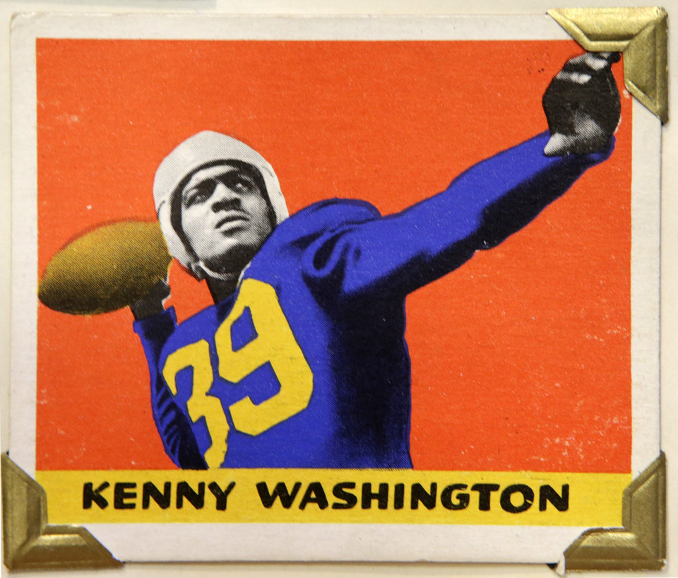 Photo - UCLA tailback and Los Angeles Rams running back Kenny Washington is shown in this 1948 Leaf Gum Company football trading card, shown Wednesday, Jan. 8, 2014, at the Metropolitan Museum of Art in New York. Washington played alongside Jackie Robinson at UCLA and in 1946 became one of the first black players in the NFL after a 12-year ban. The Met is presenting a pop-up exhibition celebrating football's history through the ages with vintage trading cards. The 150 cards, including a series from 1894, are part of approximately 600 football cards from the museum's vast collection of sport trade cards donated to the Met by the late hobby pioneer Jefferson Burdick.  The exhibit runs Jan. 24 through Feb. 10. (AP Photo/Kathy Willens)