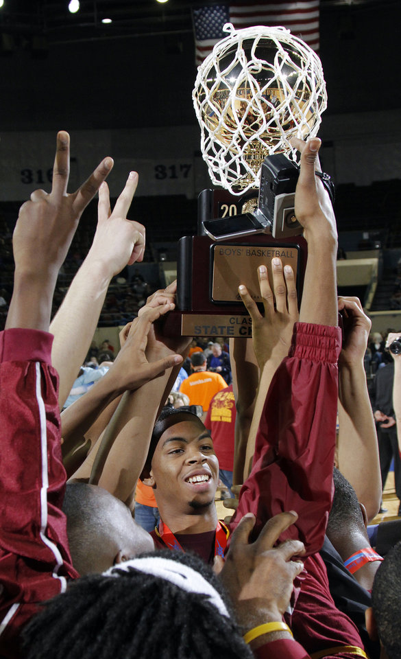 The Centennial Bison hoist their second championship trophy during the 3A boys State Basketball Championship game between Victory Christian High School and Centennial High School at State Fair Arena on Saturday, March 10, 2012 in Oklahoma City, Okla.  Photo by Chris Landsberger, The Oklahoman