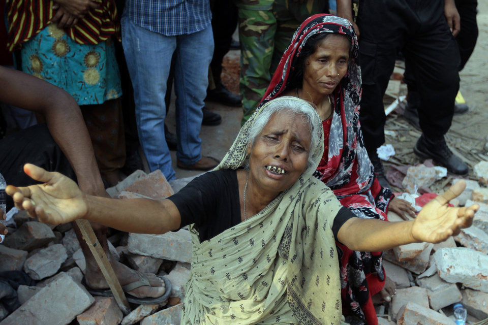Photo - A Bangladeshi woman relative of a victim cries at the site of a building that collapsed Wednesday in Savar, near Dhaka, Bangladesh, Thursday, April 25, 2013. By Thursday, the death toll reached at least 194 people as rescuers continued to search for injured and missing, after a huge section of an eight-story building that housed several garment factories splintered into a pile of concrete. (AP Photo/A.M. Ahad)