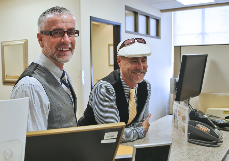 Photo - Bruce Fox, right, and Colum O'Hare apply for their marriage license in the San Diego County offices where they learned the the schedule for actual marriage ceremonies is booked through the week in San Diego, Monday, July 1, 2013. The couple said they have been together for 15 years.  (AP Photo/Lenny Ignelzi)